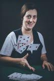 Woman gambling cards Stock Photography