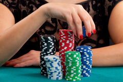 Woman with gambling chips Stock Image