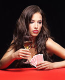 Woman gambling on red table. Pretty young woman gambling on red table royalty free stock photography