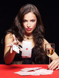 Woman gambling on red table. Pretty young woman gambling on red table Royalty Free Stock Photos