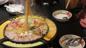Woman gang enjoy having spicy noodle soup. Stock video stock video footage