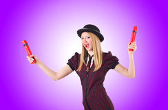 Woman gangster with dynamite sticks on white Stock Photo