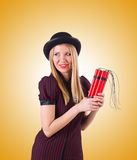 Woman gangster with dynamite sticks on white Stock Image