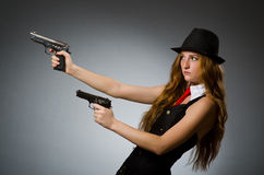 Woman gangster with gun. In hand Royalty Free Stock Images