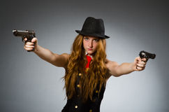 Woman gangster with gun Royalty Free Stock Photos