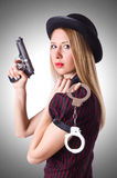 Woman gangster with gun. And money Royalty Free Stock Photo