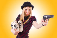 Woman gangster with gun Stock Images