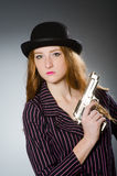 Woman gangster with gun Stock Photography