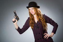 Woman gangster with gun Royalty Free Stock Image
