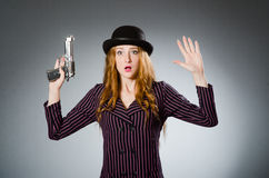 Woman gangster with gun. In vintage concept Stock Photography