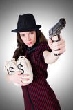 Woman gangster with handgun against the gradient Stock Photography