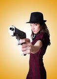 Woman gangster with handgun on white Royalty Free Stock Images