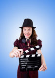 Woman gangster with movie board on white Stock Image