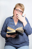 Woman gape. Attractive woman in the holding black book in the hand, gape Royalty Free Stock Photo