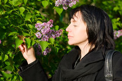 Woman in the garden. Middle aged woman smelling flowers in the park/garden Royalty Free Stock Photo
