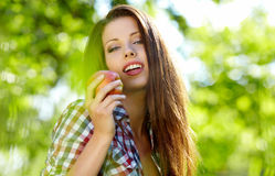 woman in the garden with apples Stock Photography