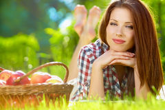 Woman in the garden with apples Stock Photos