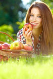 Woman in the garden with apples Royalty Free Stock Image