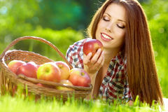 Woman in the garden with apples Royalty Free Stock Photo