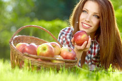 Woman in the garden with apples Stock Image
