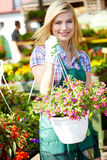 Woman  in garden center Royalty Free Stock Photo