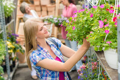 Woman at garden centre shopping for flowers Royalty Free Stock Photo
