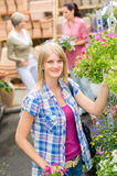 Woman at garden centre shopping for flowers Royalty Free Stock Photography