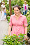 Woman at garden centre shopping for flowers Stock Photography