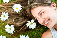 Woman in a garden of daisies Royalty Free Stock Photography