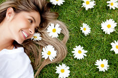 Woman in a garden of flowers Stock Photo