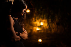 Woman in a Garden at Night Stock Images