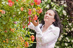 Woman in garden rose check disease Stock Image