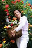 Woman in garden with roses Royalty Free Stock Photos
