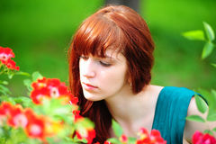 Woman in garden of roses Stock Photo