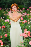Woman in a garden of roses Stock Images