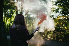 Woman in garden with smoke Stock Photo