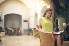 Woman in a garden. Woman in yellow dress in a garden Stock Photography