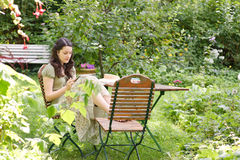 Woman in a garden Royalty Free Stock Image