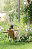 Woman in a garden Stock Photos