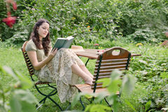 Woman in a garden Stock Photography