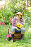 Woman in the garden Stock Images
