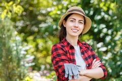 Woman gardener holding protective gloves Stock Photo