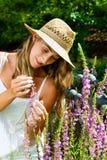 Woman gardener standing in the garden Stock Photos