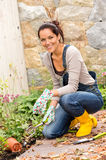 Woman gardening autumn flowers yard housework Stock Photos