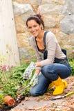 Woman gardening autumn flowers yard housework. Happy woman gardening fall yard housework flowerbed hobby Stock Photos