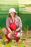 Woman with gardening tool working in garden Royalty Free Stock Images