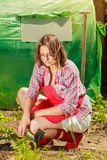 Woman with gardening tool working in garden Stock Photography