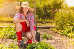 Woman with gardening tool working in garden Royalty Free Stock Photo