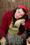 Woman gardening - whiping off her sweat Stock Photography