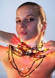 Woman with garland. Woman with holliday garland on her neck Royalty Free Stock Images